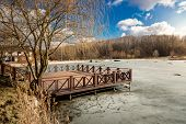 image of pier a lake  - Beautiful wooden pier on lake covered by ice at sunny day - JPG
