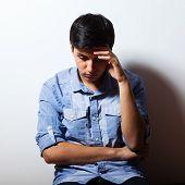 picture of depressed  - Portrait of depressed man sitting on floor - JPG