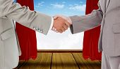 picture of curtains stage  - Side view of shaking hands against stage with red curtains - JPG