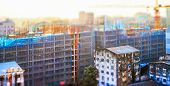 stock photo of tilt  - Aerial cityscape panorama view of building construction at sunrise. Tilt shift effect. Yangon Myanmar (Burma) travel landscapes and destinations
