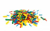 stock photo of butt plug  - Four color plastic dowel pin pile isolated over white background - JPG