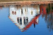 image of upside  - family home mirroring in a pond upside down - JPG