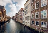 pic of row houses  - The Church of Our Lady and a row of canal houses in the Dutch city of Dordrecht - JPG