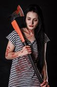 pic of bloody  - Young woman with a big bloody axe over black background - JPG