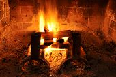 stock photo of cozy hearth  - Warm and cozy fireplace with wood logs - JPG