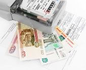 picture of electricity meter  - Eenergy meter demandbill and money on white isolated - JPG