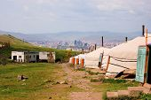 stock photo of bator  - Mongolian ger tents in the hills above Ulan Bator - JPG