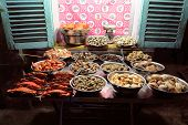 stock photo of tropical food  - Street Vendor in Ho Chi Minh City, Vietnam selling fresh seafood on the sidewalk. Seafood is a favorite dinner food of Vietnames people, Saigon, Vietnam