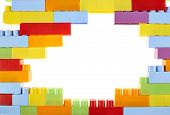 image of brick block  - Copyspace background composition made of toy construction brick blocks against the white backdrop  - JPG