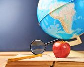 image of geography  - Studying geography composition of the red apple - JPG