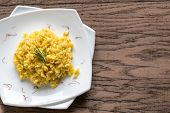 stock photo of saffron  - Risotto With Saffron On The Wooden Background - JPG