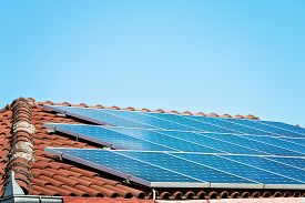 foto of roof-light  - Solar panels on the roof of private home - JPG