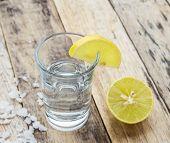 pic of vodka  - Vodka with lemon on wooden table background  - JPG