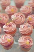 image of buffet  - Delicious sweet buffet with cupcakes topped with rose