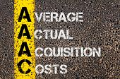 picture of average looking  - Concept image of Business Acronym AAAC as Average Actual Acquisition Costs written over road marking yellow paint line - JPG