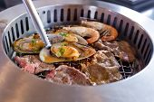 picture of braai  - Mixed Roasted Meat and Seafood on the BBQ Grill on roast - JPG