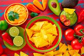 image of nachos  - Mexican food nachos and guacamole with chili peppers and sauces - JPG