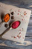 picture of saffron  - Different spices selection in old metal spoons over wooden background - JPG