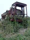 image of crippled  - Rusty combine harvester photographed at Kennack Sands in Cornwall