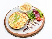 picture of scallop shell  - stuffed scallop on wooden plate with garnish - JPG