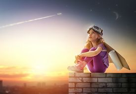 stock photo of spaceman  - child is dressed in an astronaut costume - JPG