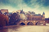 Pont Neuf in central Paris, France.  The Pont Neuf  is the oldest standing bridge across the river S poster