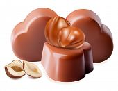 Photo-realistic vector illustration of chocolates. Chocolates with hazelnuts.