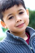 Young Boy Smiling Outdoors