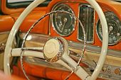 image of luxury cars  - Close up of the steering wheel of a classic old car - JPG