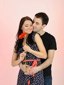 Lovely Romantic Couple With Flower Embracing