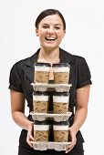 pic of cup coffee  - Businesswoman carrying stack of coffee cups - JPG