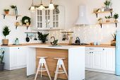 Modern Kitchen Interior With Island, Sink, Cabinets In New Luxury Home Decorated In Christmas Style poster