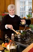 Mature Woman Cooking Healthy Food.