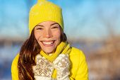Winter Asian woman smiling in cold weather fashion accessories for winter: yellow hat and knit scarf poster
