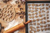 Making Christmas Gingerbread Cookies Flat Lay. Raw Cookies On Baking Tray And Wooden Rolling Pin On  poster