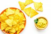 Snack For Party. Mexican Nachos Near Guacamole Sause On White Background Top View poster