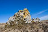 Mountain stone on blue sky background
