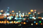 De Focused/blur Image Of City At Night.blurred Urban Abstract Traffic Background.night Blurred Bokeh poster