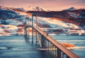 Beautiful Bridge At Sunset In Lofoten Islands, Norway. Aerial Winter Landscape With Cars On The Road poster