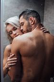 Young Passionate Couple Hugging And Kissing While Taking Shower Together poster