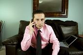 Businessman Talking On The Phone Sitting On The Couch