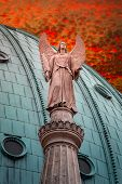Statue Of Winged Angel At Evangelical Church Saint Nikolai At Sunset, Potsdam, Germany poster