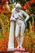 Statue Of Sensual Renaissance Era Roman Man In Lion Skin With Hunting Tube At Golden Autumn, Potsdam poster