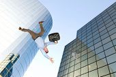 image of life after death  - A businessman falls from a building rooftop after too much emotional stress at work caused him to commit suicide - JPG