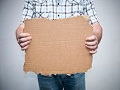 Hand holding blank cardboard