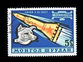 MONGOLIA - CIRCA 1957: A stamp printed in Mongolia shows the Soviet spaceship and Laika - the first dog in space, circa 1980