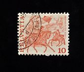 HELVETIA (SWITZERLAND) - CIRCA 1986: A Stamp printed in the HELVETIA shows man on horseback holding a flag in his hands , circa 1986 .