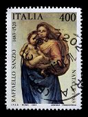 ITALIA - CIRCA 1983: a stamp printed in Italia shows a picture of Virgin Mary holding Child Jesus, painted by Raphael, the famous Italian Renaissance artist. Ajman, circa 1983