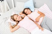 Pajama Party And Friendship. Sisters Happy Small Kids Relaxing In Bedroom. Friendship Of Small Girls poster