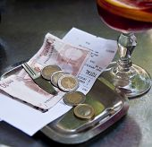 stock photo of spanish money  - Restaurant bill and money on matal tray - JPG